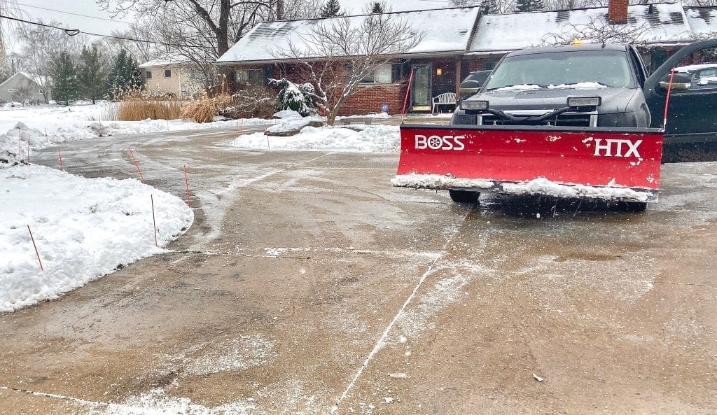 Snow plowing a driveway in Northville, Michigan with a Boss Snow Plow